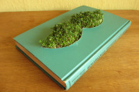Grow a moustache out of a book