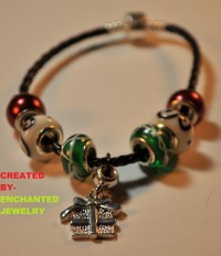 """A True Christmas Present""-Bracelet 	 This is a True Christmas Present!! It is a bracelet featured on a Black Braided Cord. This is a one of a kind, Christmas bracelet made by EnchantedJewelry.  This product is Already made and Ready to Ship As Soon As you Order. PRICE$10"