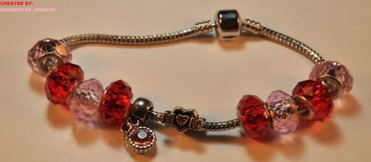 PINK RHINESTONE MOM BRACELET A MOM charm, but instead of a O it features a Heart with a Pink Rhinestone, Also a silver dangle charm with a Pink Rhinestone in the Middle of the Heart  This product is Already made and Ready to Ship As Soon As you Order. PRICE-$10