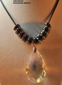 "My ""BLINGY"" Teardrop-Necklace  This is a One-Of-a-Kind Necklace, presented to you from EnchantedJewelry. This is the Perfect thing you need, and the Only thing you will Ever need if you are Looking for Bling!! The Teardrop is pretty BIG!! And it's a Crystal Clear, Glass Bead!! This product is Already made and Ready to Ship As Soon As you Order. PRICE$12.00"
