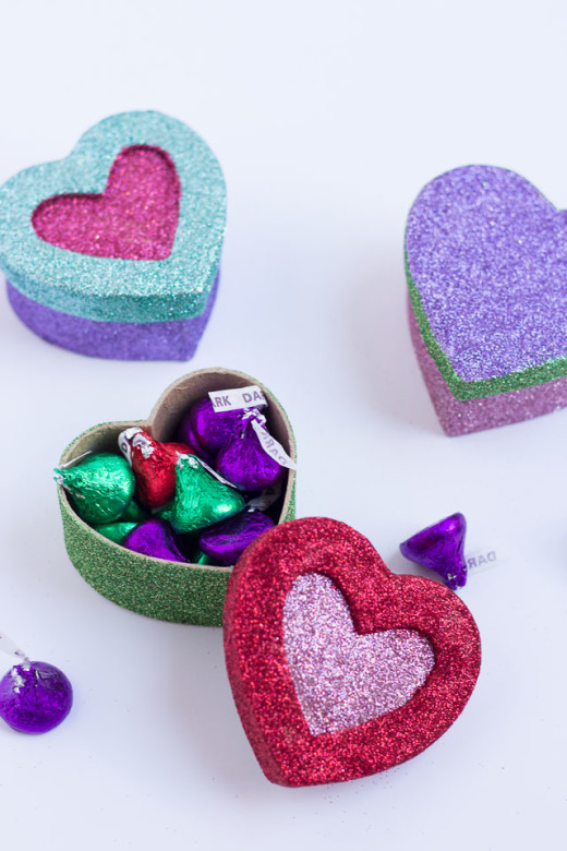 DIY Glittered Heart Boxes | Valentine's Day Ideas  Materials:  Supplies for Glitter Boxes       – Glitter Set   – Small paper mache heart boxes    – Mod Podge     – Foam brush    – Small brush    – Paper plates     -clear acrylic sealant spray