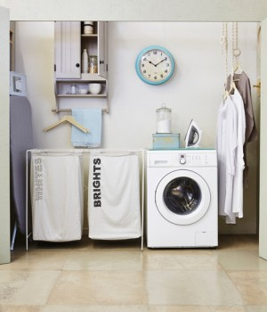 Laundry clean-up | DIY neat washing baskets  You will need:  • 240 x 150cm cotton fabric • printed fabric offcuts • template for letters • fusible interfacing • dressmaker's tracing paper and tracing wheel • 60cm Velcro (2cm wide) • matching coloured threads