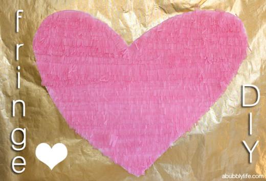 Fringe Over-Sized Heart DIY  Materials: – Foam Board or Cardboard – Pencil – Tissue Paper – Fringe Scissors – Standard Scissors – Mod Podge – Small Paint Brush