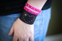 DIY Leather Bracelet for Valentine's Day  You will need:      – A strip of craft leather or scrap leather from an old purse or coat   –  Heart shaped brads  – Embroidery thread and needle    – Button