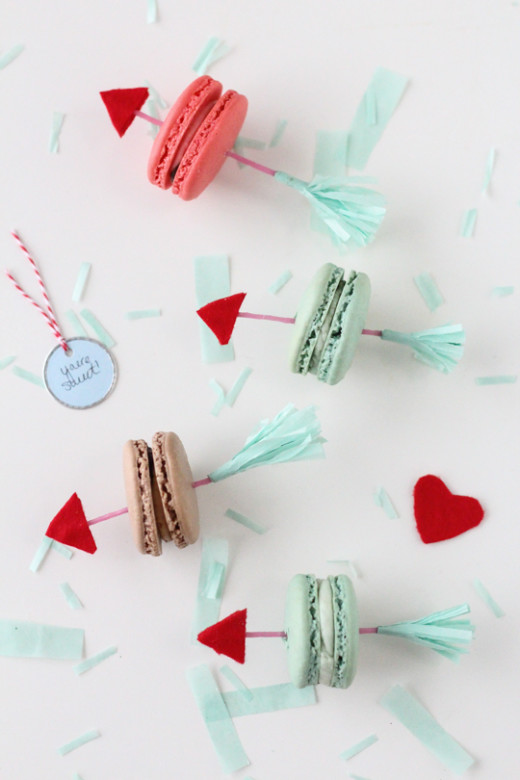 DIY // Valentine Arrow Cookie Picks   Materials:     – Toothpicks or skinny candles    – Adhesive felt    – Scissors    – Fringe Scissors     – Tissue paper     – Tacky glue