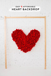 "Heart Backdrop DIY   You'll need:  • chicken wire (4ft by 6ft) • 3 pieces of 1"" x 2"" wood, 6ft tall • spray paint • hammer • nails • napkins • staple gun"