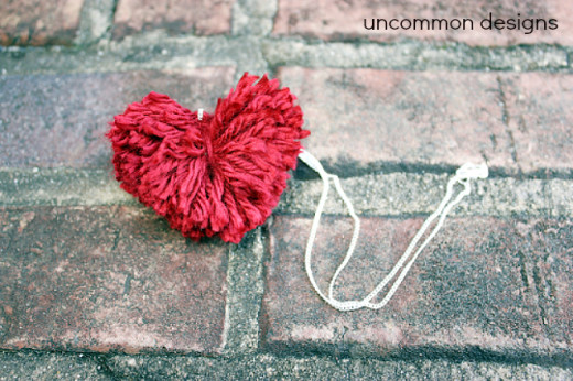 Valentine Heart Pom Pom Necklace. Awesome DIY project from Uncommon Designs…
