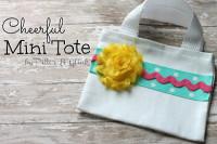 PitterAndGlink: {Cheerful Embellished Mini Tote}